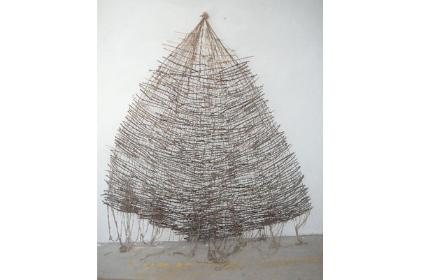 """""""River Stix"""" made of sticks that I collected from the forest and wool that I spun / 3.5 x 2.5 m, 2007"""
